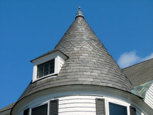 Grey slate tiles on a spire style roof