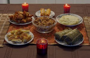 traditional christmas food on table with candles