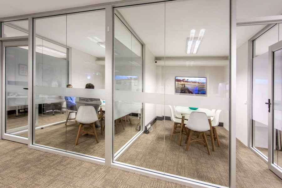 meeting rooms with floor to ceiling glass walls