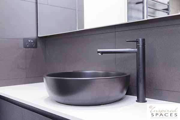 Black tapware and top mount basin