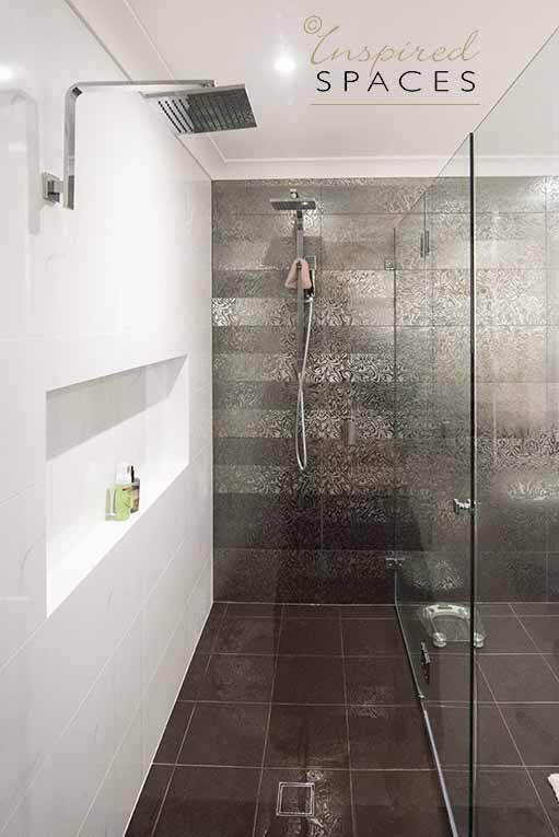 Wouldn't you want to get up in the morning just to enjoy a rainbow shower in this double shower?