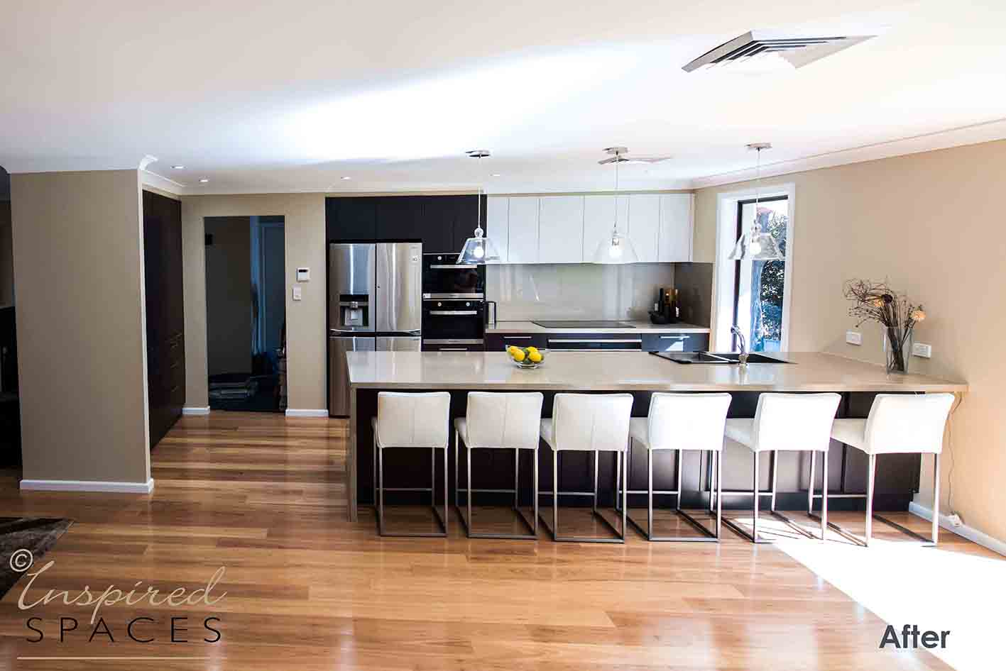 New kitchen with island bench, breakfast bar and pendant lights