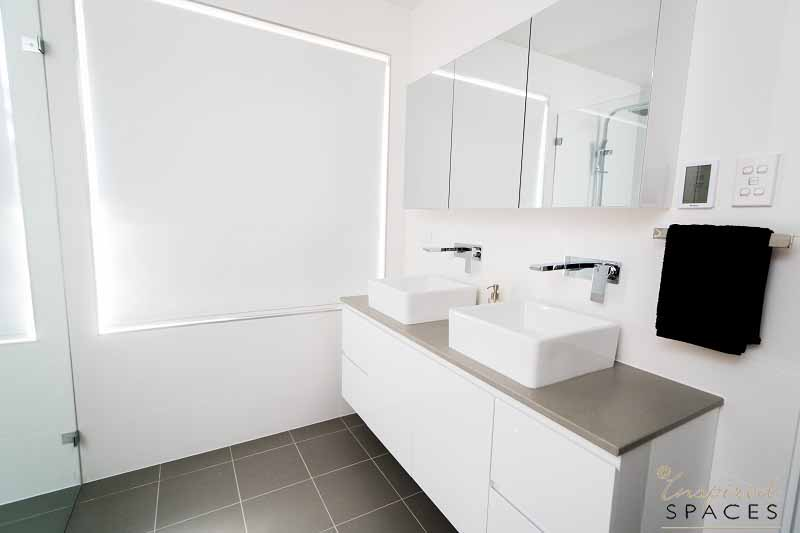 This double vanity in the ensuite has ample storage and bench top space