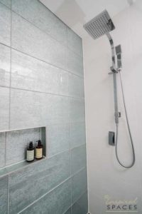 A dual shower head includes a rain shower and a hand held shower head