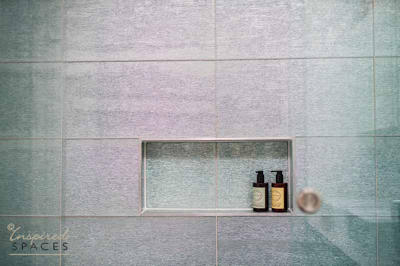 A recess in your shower is handy for your body wash and shampoo.