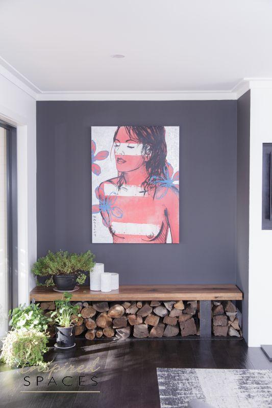 Artwork on dark grey wall in living area