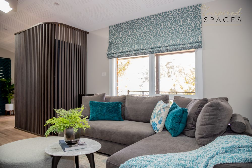 Grey sofa and blue accents in living room
