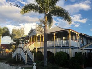 Typical 2 story Queenslander home with prominant front staircase