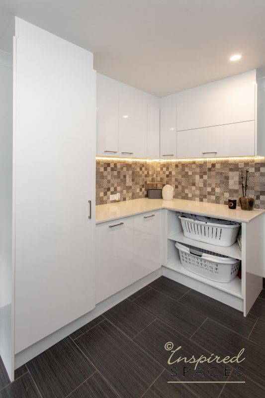 modern laundry with white cabinets