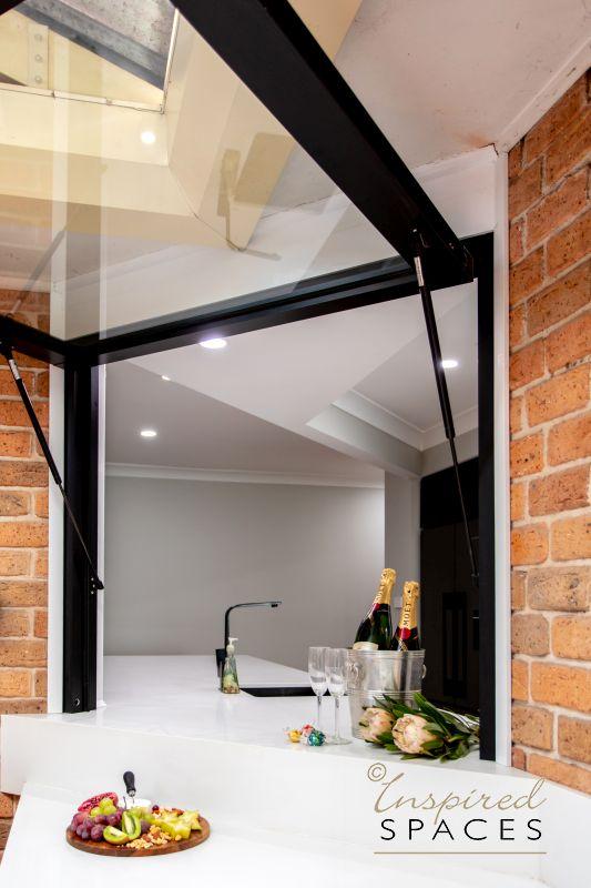 Kitchen gas lift window