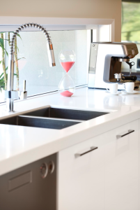 Kitchen-Sink with white bench top and cabinetry