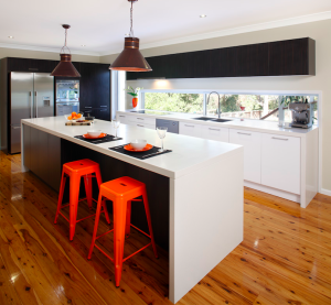 Kitchen-Stools against island bench with pendant lights