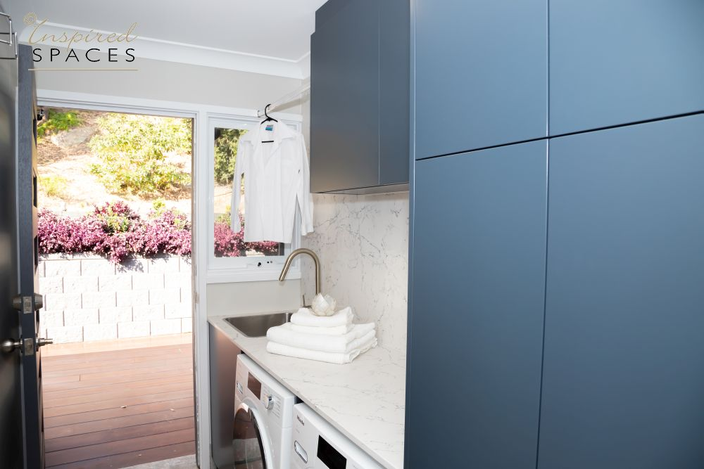 Laundry with blue cabinets