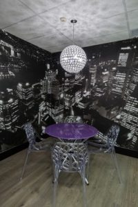 Casual meeting space by Inspired Spaces. The wallpaper mural is custom made displaying Sydney's skyline.