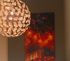 Wall art with pendant light hanging in front