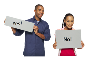 A couple standing with 'yes' and 'no' cards