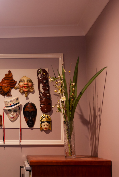 the colour purple on a wall with feature masks for artwork