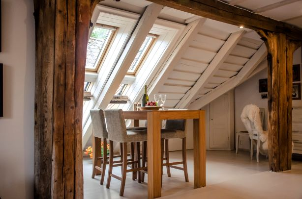 The skylights in this roof conversion makes the space look bigger and more open