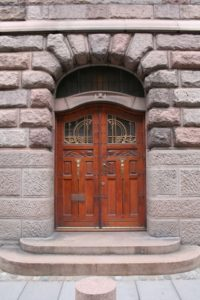 Timber double doors with art nouveau glass details