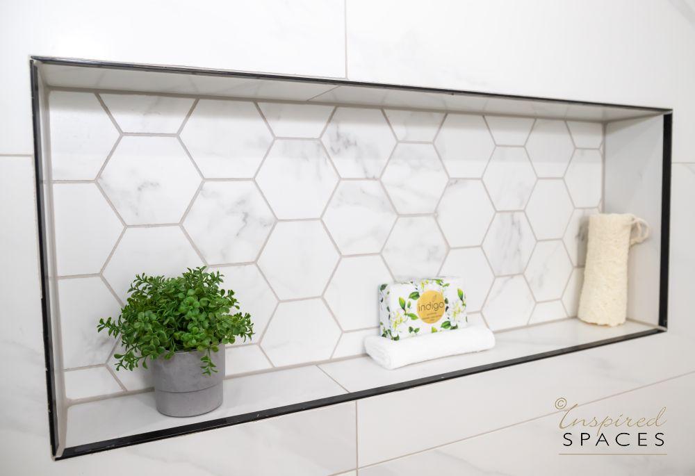 shower niche with hexagonal tile