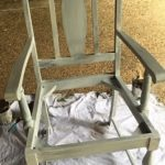 old timber chair stripped back and undercoated ready for a repaint