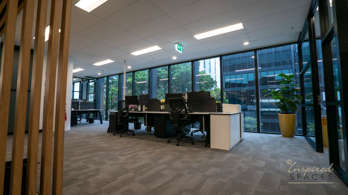 white workstations with view to greenery