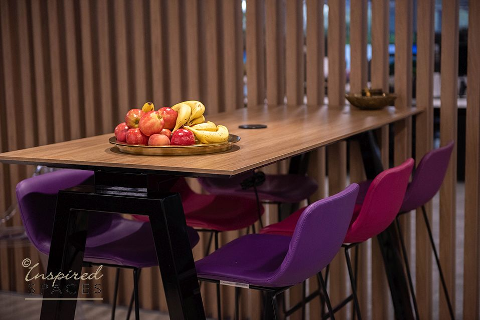 bench table with colourful chairs