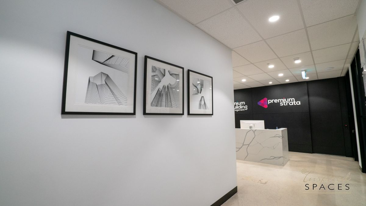 entry to office with line drawing of buildings