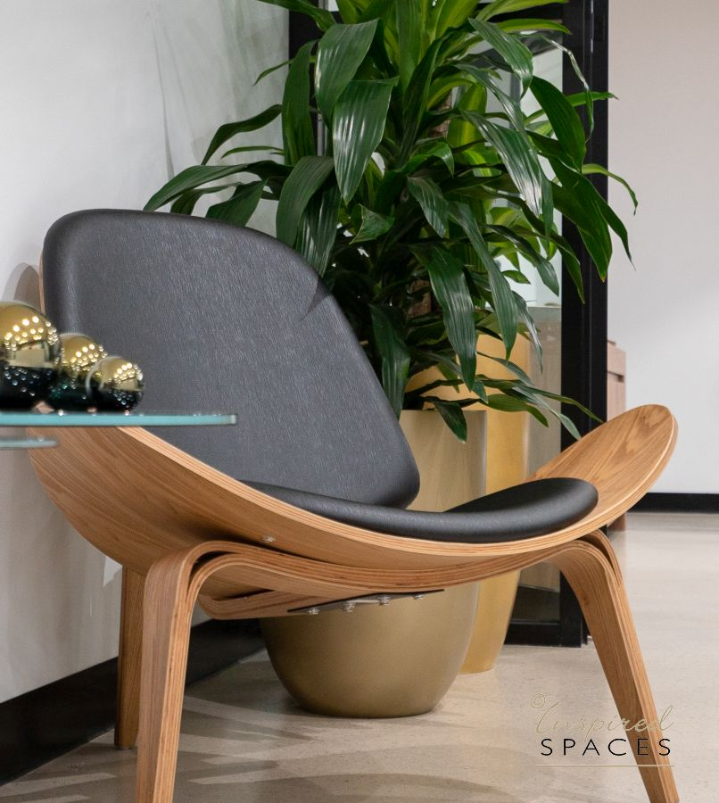shell chair and gold pot plants