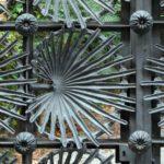 Metal gate with art nouveau decorative leaf embellishments