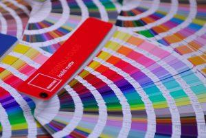 Pantone colour fandecks opened like fans to show the beautiful colours