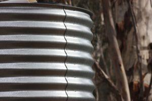 Corrugated metal water tank