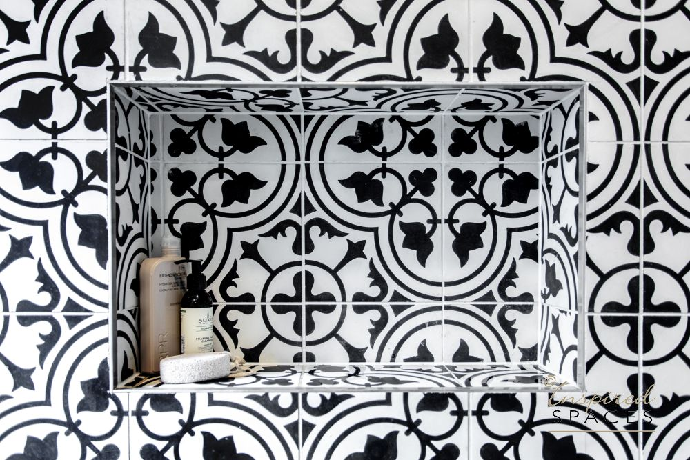Feature bathroom wall withblack and white tiles